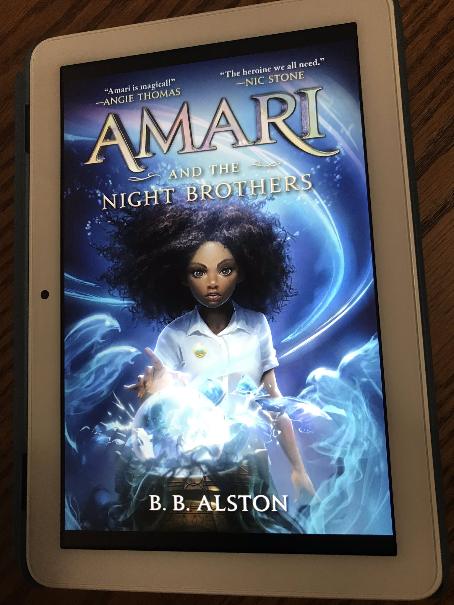 book cover for Amari and the Night Brothers on e-reader